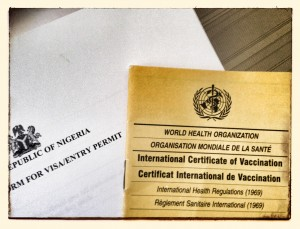 Nigerian visa application form with vaccination booklet