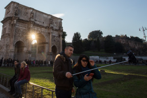 Tourists taking a selfie at the Colosseum